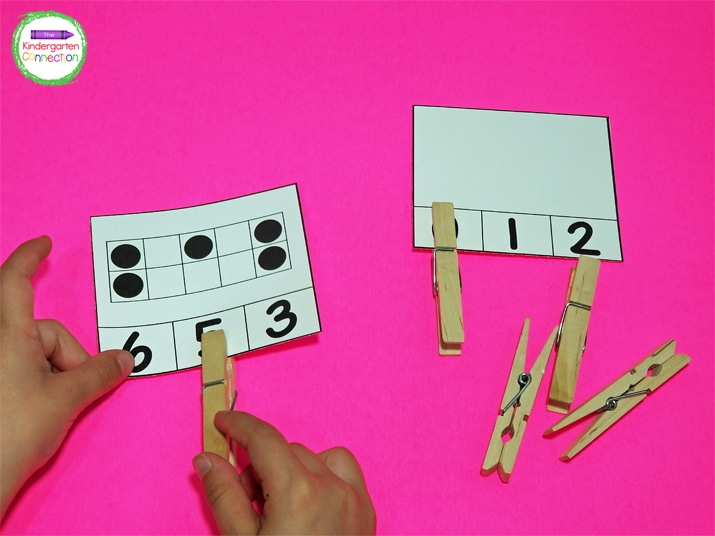 Pinching the clothespins to open and close them on the math clip cards  is great fine motor skills practice.