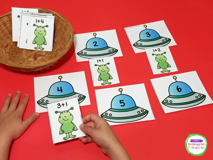 Place the spaceship cards face up and pick an addition facts card out of the basket to match up with the sums.