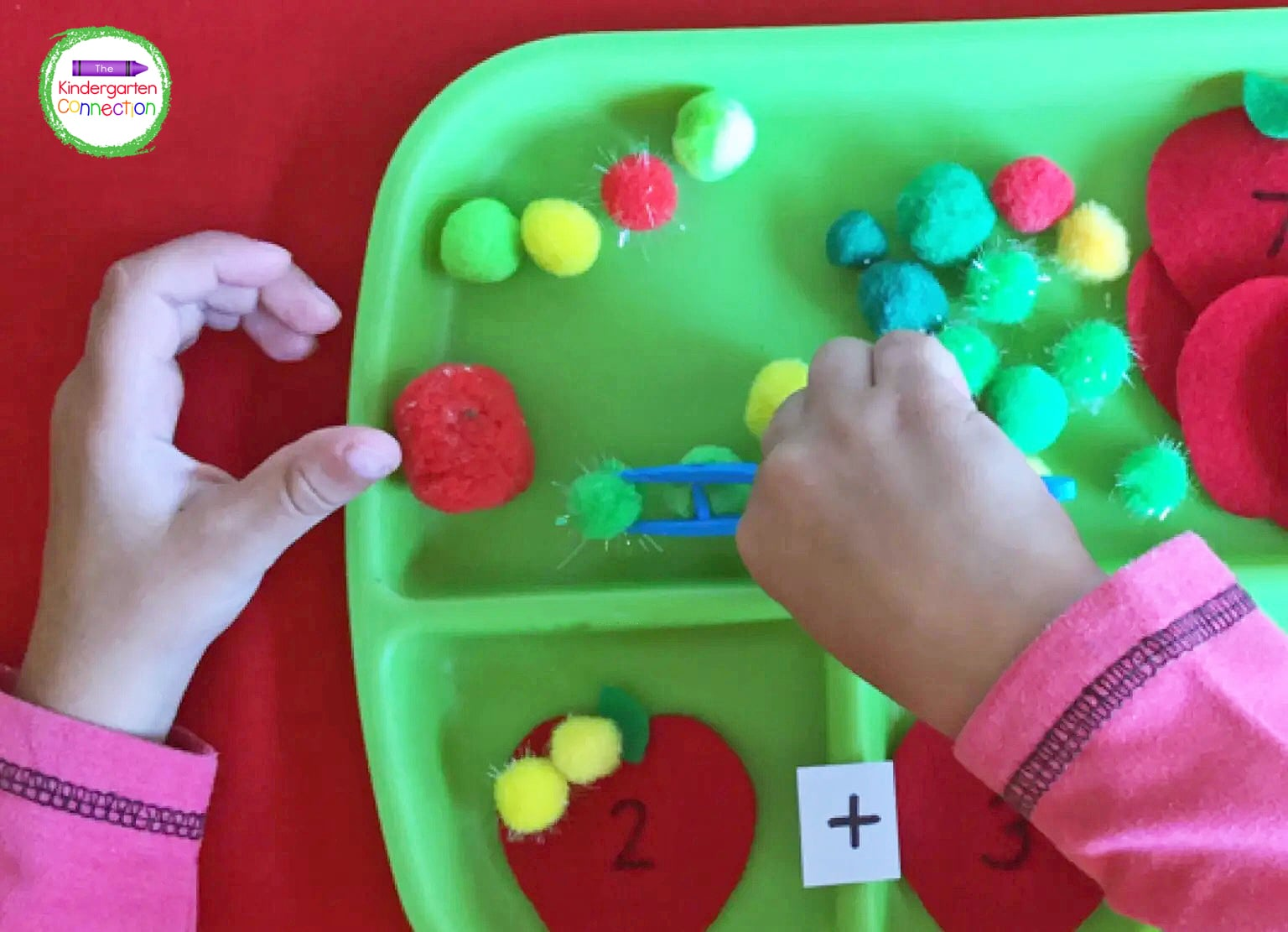 The jumbo tweezers provide great fine motor practice as kids use them to pick up the pom poms.
