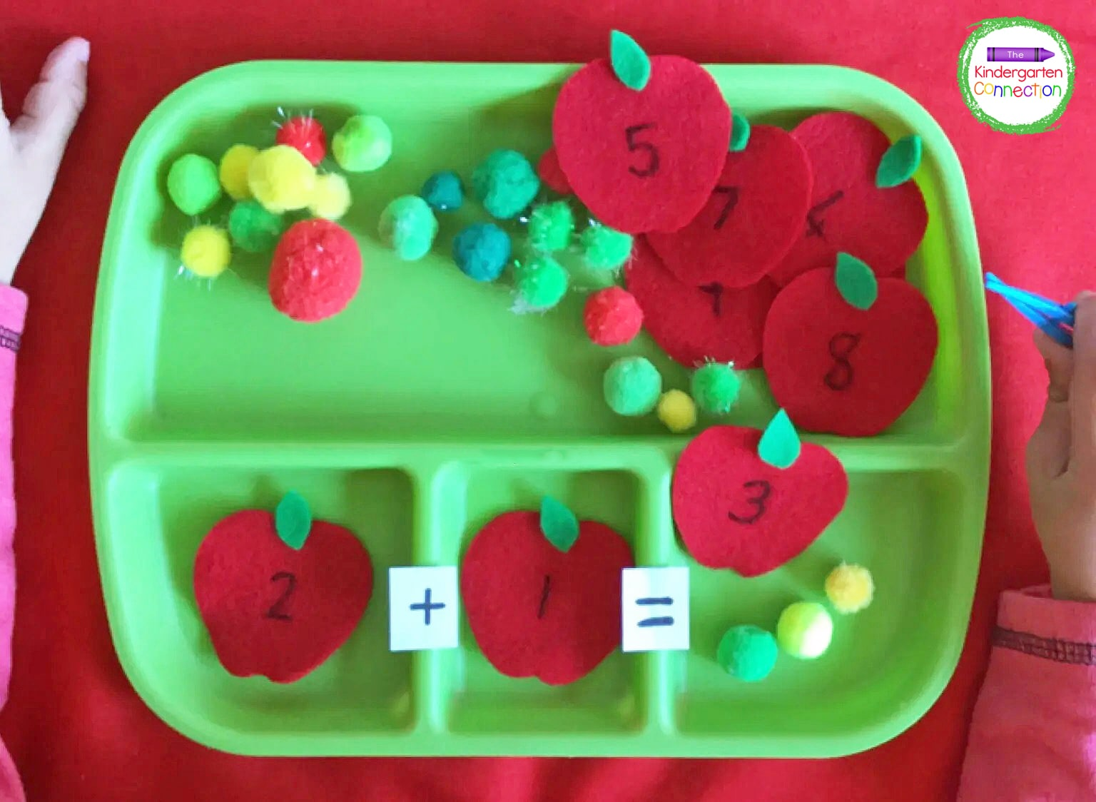 Kids can place the apples in the tray compartments to build the addition sentences.
