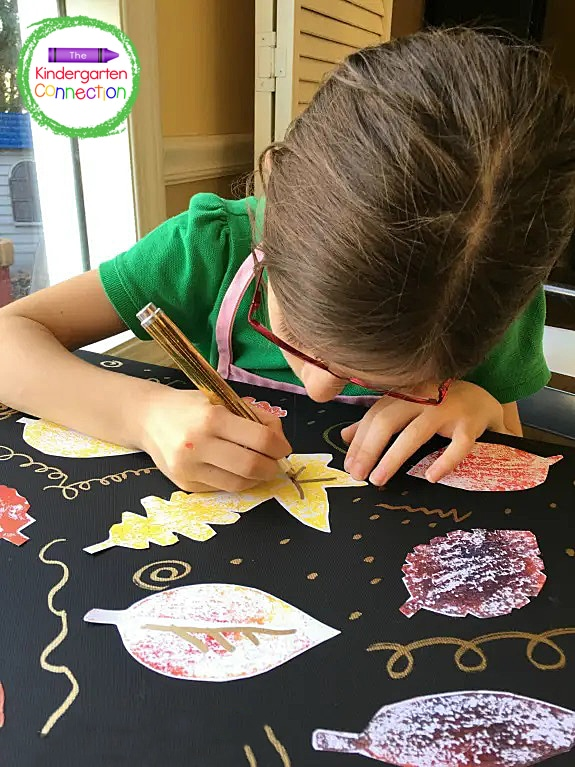 Once dry, students may want to use metallic markers or pens to add embellishments to their Autumn artwork.