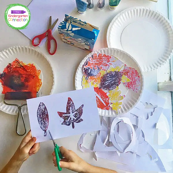 Use a brayer to cover the leaf stamps with paint and stamp onto thick cardstock paper. Allow to dry completely.