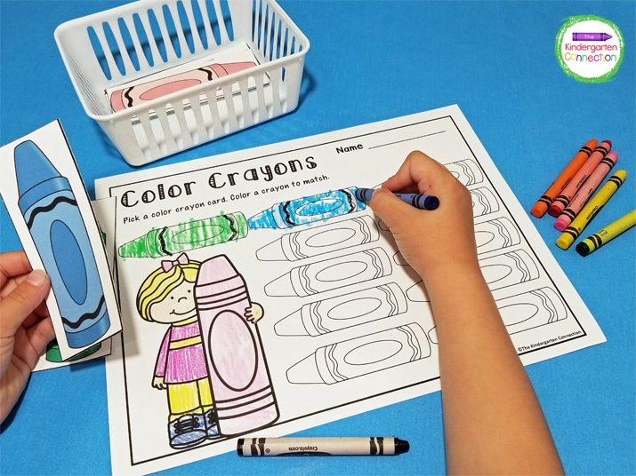 For this Color Crayons center, students pick a crayon and color one on the recording sheet to match.