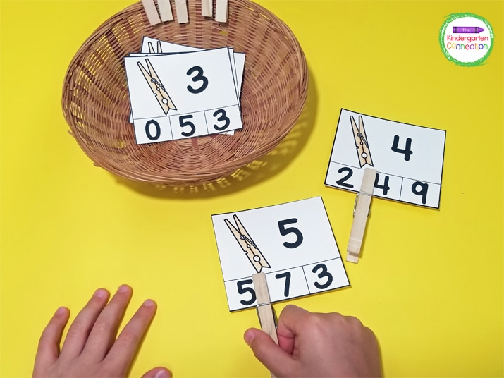 For this number clip card match, students look at the top number on the card and use a clothespin to clip the matching number.