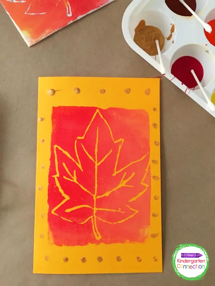 Flip the stamp over onto a sheet of cardstock paper. Carefully lift up the stamp to reveal your block printed leaves craft for kids!