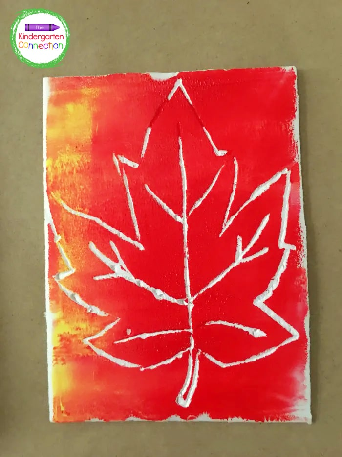 Once the brayer is covered with ink, invite students to roll the brayer over their leaf stamps and cover the entire surface.