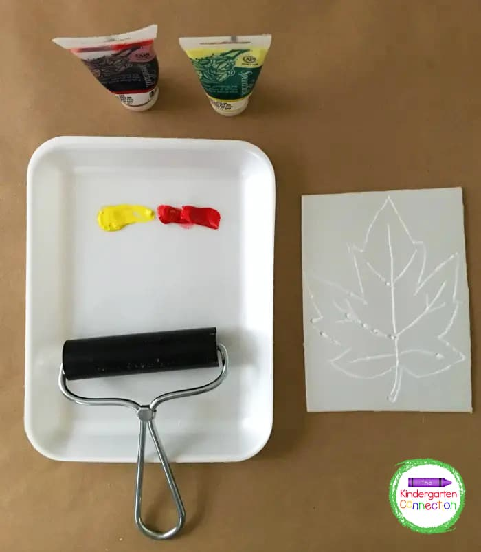Invite students to roll the brayer into a foam tray with yellow and red block printing ink.