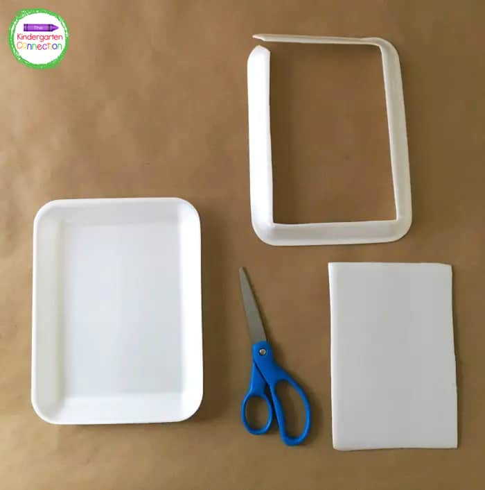 To begin this fall leaves craft for kids, use scissors to remove the outer rim from a foam tray as shown.