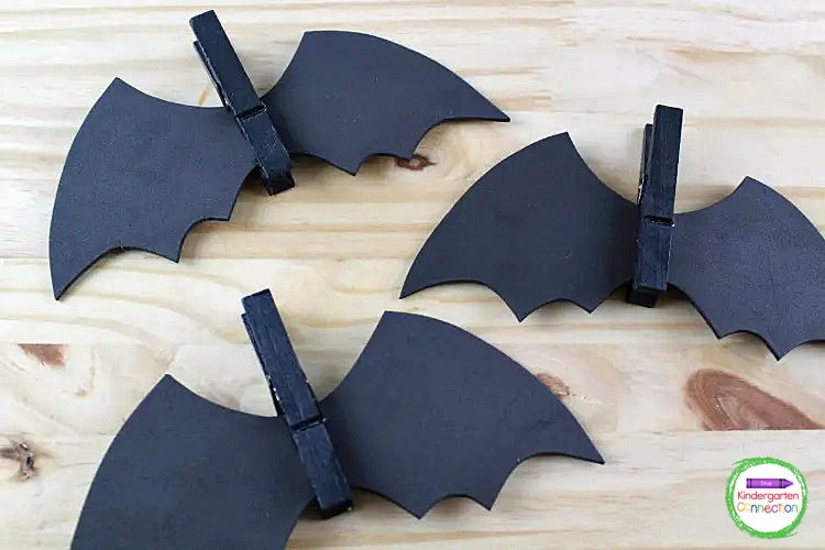 Now that you have your pieces, squeeze open a dry clothespin, add a dab of glue and insert your bat wings.