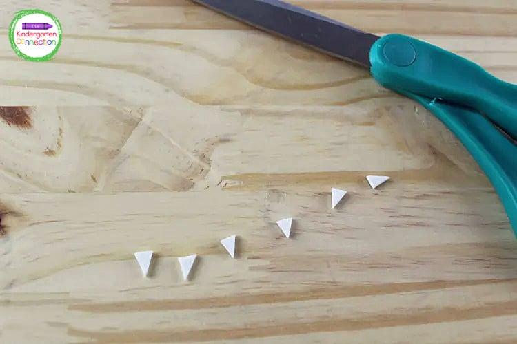 Then use your white foam to cut small triangles for bat fangs.