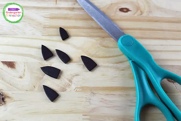 Next, cut triangle shapes out of black craft foam for bat ears.