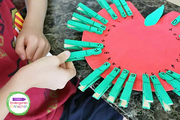 Opening and closing the clothespins is great fine motor practice for early learners.