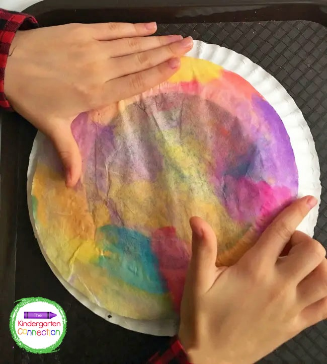 Next, add the painted coffee filter on top. Allow the glue to dry completely.