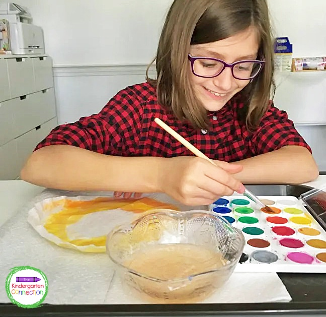 While the plate is drying, students can begin using watercolor paints on a coffee filter.