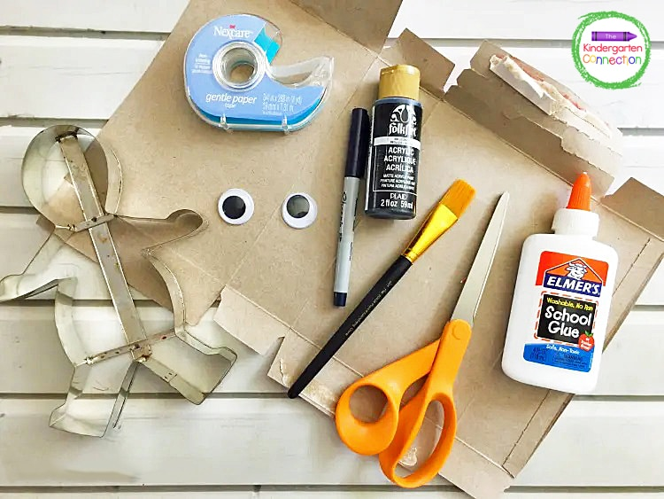 Grab a cookie cutter, black paint, bandage tape, googly eyes, and glue to make this cute mummy craft.