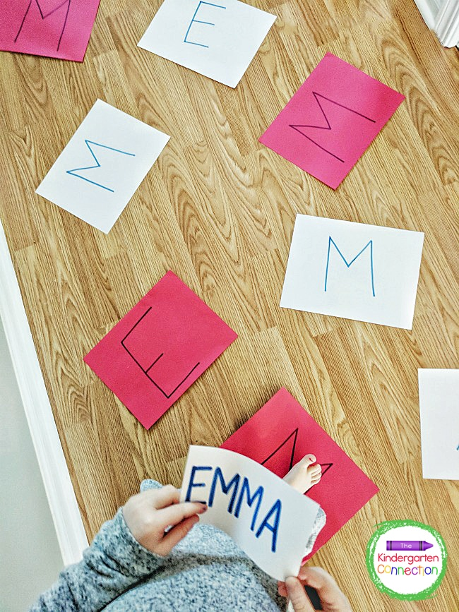 For this activity, I wrote all of the name letters on pieces of paper and spread them out on the floor for my daughter to jump to.