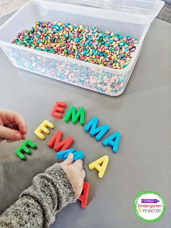Kids can find the magnet letters in their name in the sensory bin, pull them out, and spell their name.