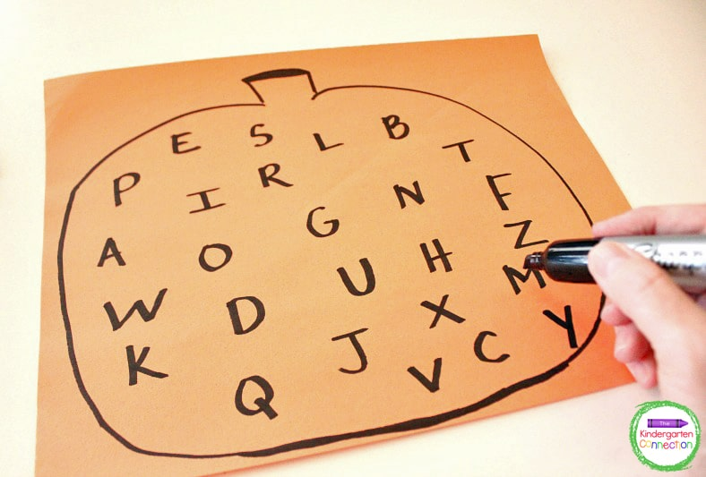 Just grab a black marker and quickly sketch out a large pumpkin with the alphabet onto a piece of orange construction paper.
