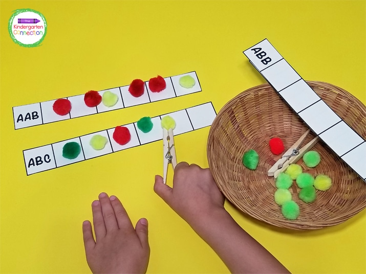"""To play, students simply look at the pattern label in the first box and use the """"apples"""" to build that pattern on the pattern strips."""