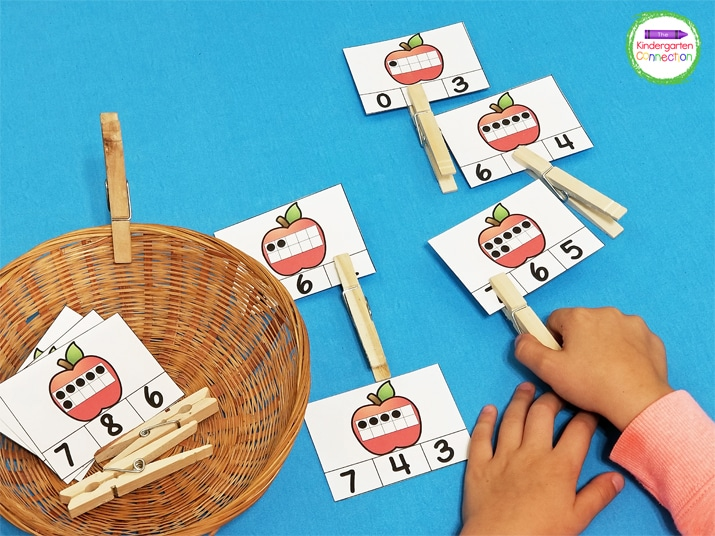 Students will count the number in the apple ten frame and clip the matching answer on the card.