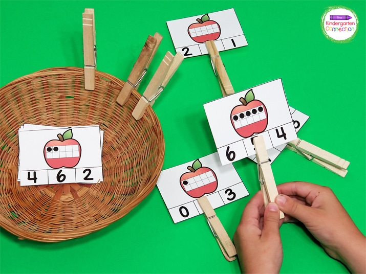 Kids will build fine motor skills by clipping and unclipping the clothespins on the apple ten frame cards.