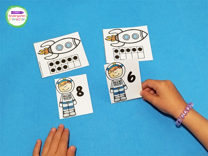 Students can take turns matching the astronaut number card with the ten frame rocket card.