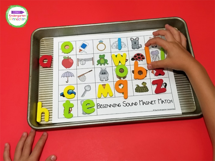 Kids pick a letter magnet and find a picture with the matching beginning sound on the game board.