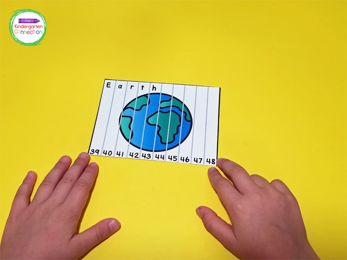 Each counting puzzle has 10 pieces. To start, we spread them out on the table and started putting numbers in order to form the planet.