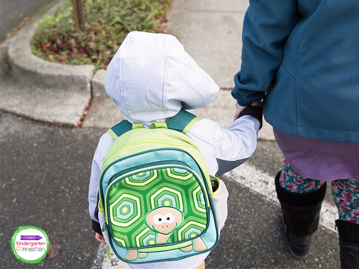 Putting backpacks on can be tricky and require a lot of practice.