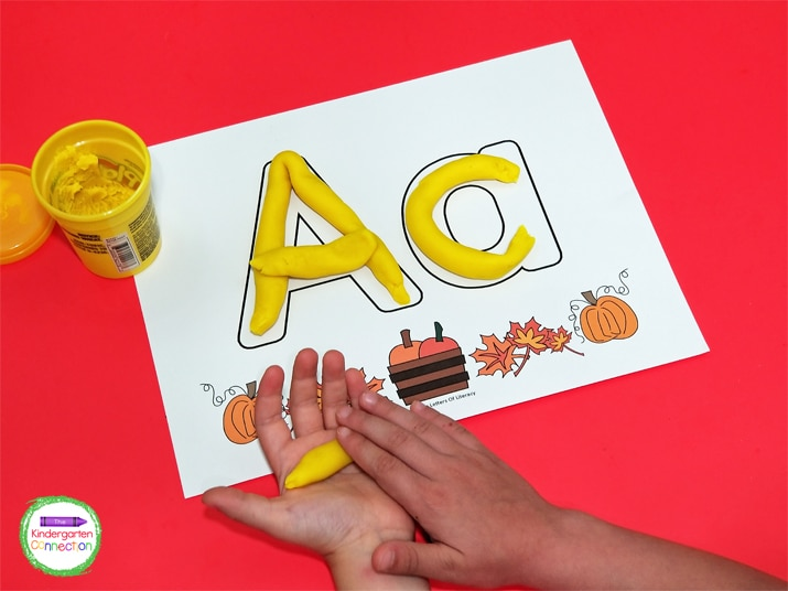 Each page shows both uppercase and lowercase letters and is decorated with fun fall leaves and pumpkins.