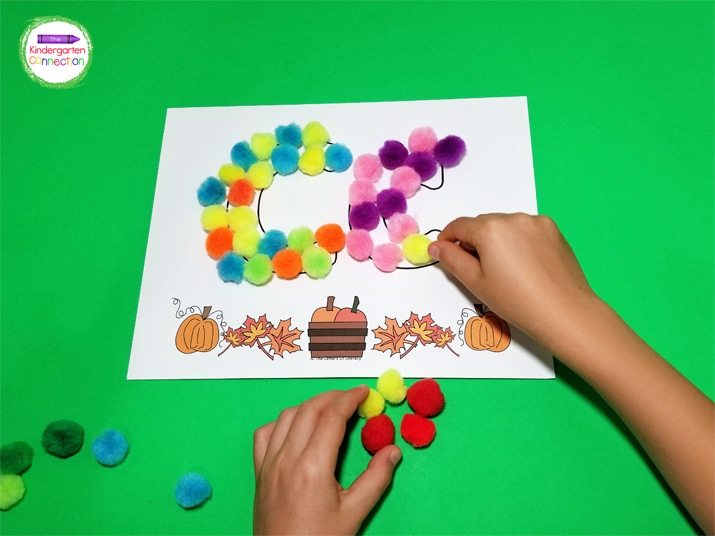 Instead of play dough, kids can use pom poms to fill in the letters.