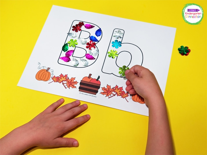 Students can use fun fall-themed confetti to fill in the letters on the alphabet mats.