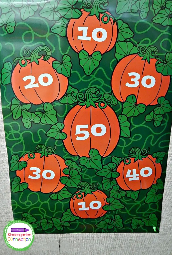 In this bean bag toss, you can play by taking turns and seeing who can hit the highest number, or you could add up totals and see who got the most.