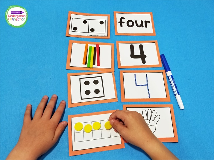 Choose a color of paper to use for each number. Cut the number cards out and glue themonto the colored paper.