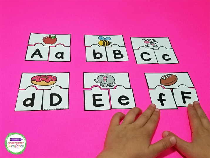 For alphabet activities, we start with just a few letter pieces, not the whole alphabet.