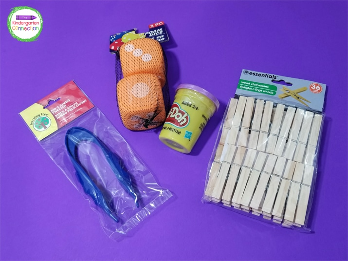 Dollar store teacher supplies like jumbo tweezers, dice, play dough, and clothespins are great for the classroom.