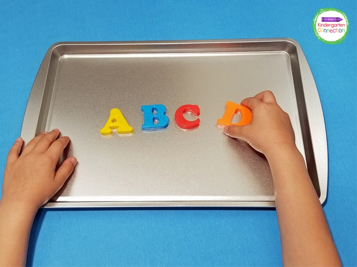 We love to use cookie sheets for fun literacy and math activities paired with our magnetic letters and numbers.