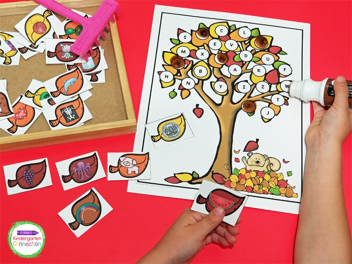 Print out the tree mats and use dot markers to cover over the letters.