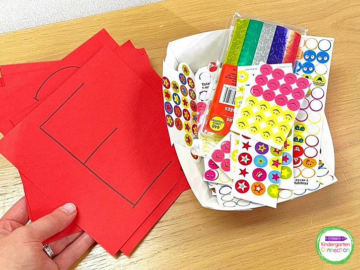 Write the first letter of your students' names on small paper with black marker and grab some stickers.