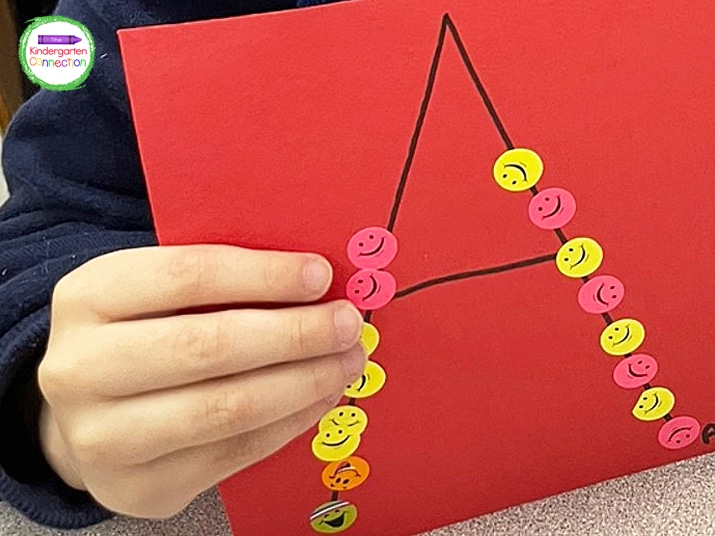 Peeling and placing the stickers on the first letter of their names will help students strengthen fine motor skills.