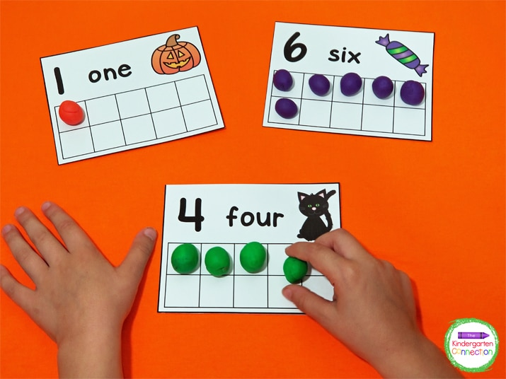 This set of counting cards includes a fun pumpkin, candy, or cat theme on each card.