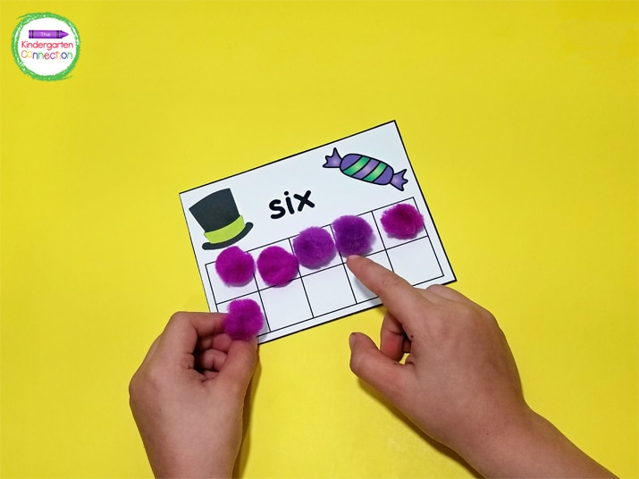Kids pick a card, identify the number, and then count out the corresponding number of manipulatives to place on the card.
