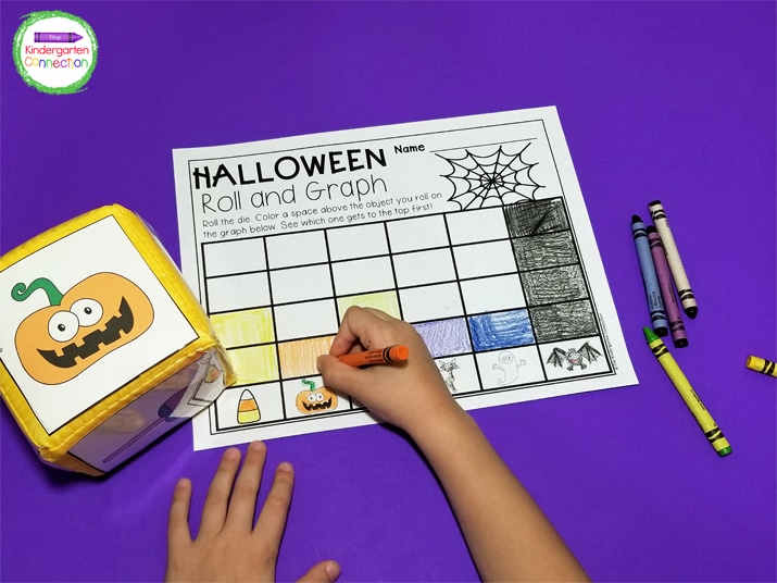 Students roll the die and color one square above the matching picture on their recording sheet.