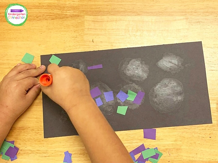 Students can use their scissor skills to cut the paper strips and glue them on the background.