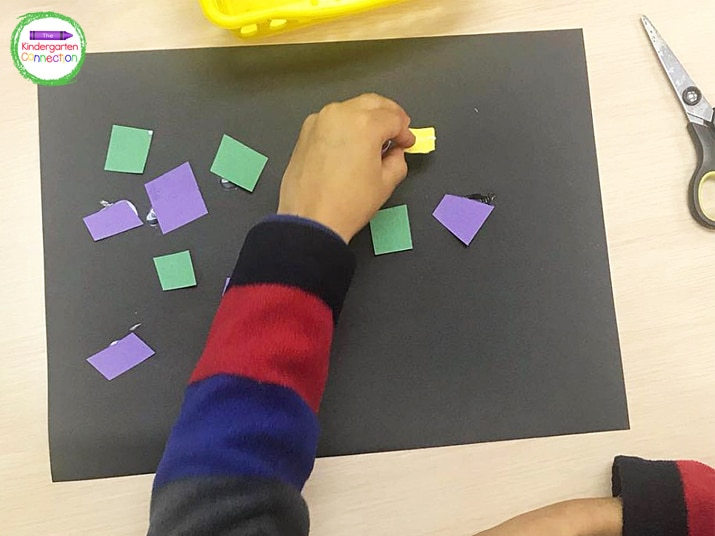 The black background makes the colored paper mosaic pieces pop!
