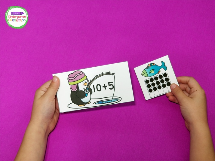 To prep, print out the penguin addition cards and 20 frame fish cards, laminate, and cut them apart.